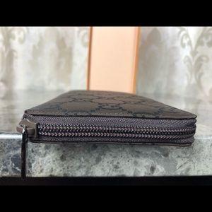 Gucci Bags - Gucci Signature Zippy Wallet